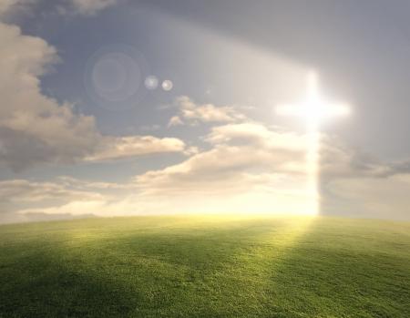 hope symbol of light: Bright glowing cross on grassy background.