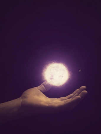 An open hand holding the solar system. Stock Photo