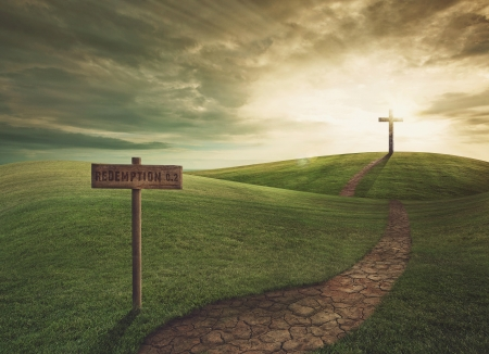 christian faith: Cross on top of the hill at sunset Stock Photo