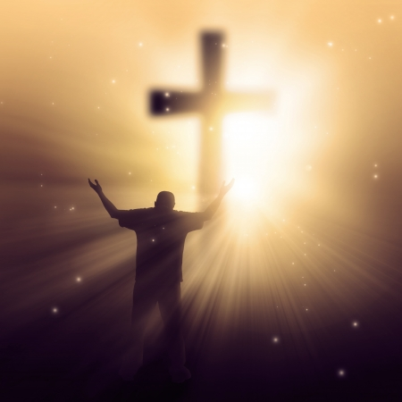 A man walking towards a cross with sunbeams photo
