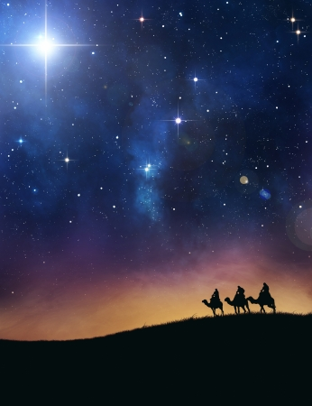 Three wise men following the star of bethlehem. Stock Photo