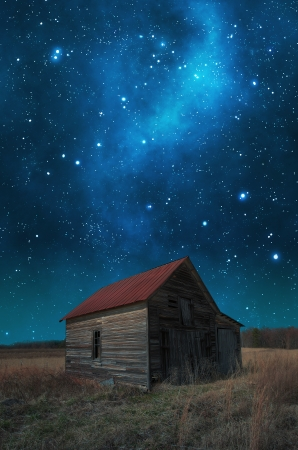 Red roof barn before the milky way galaxy. photo