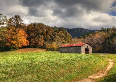 Old barn with beautiful fall colors and cloudy skies. photo