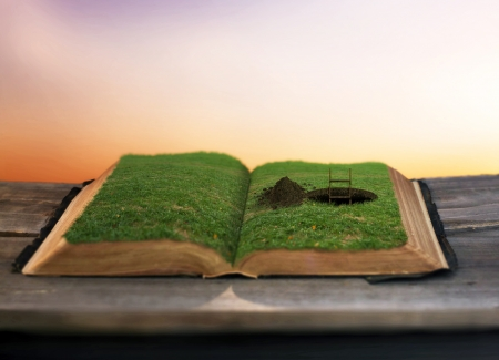 Surreal image of a pathway being dug inside a Bible.