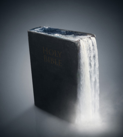 Waters flowing out of an old black Bible.