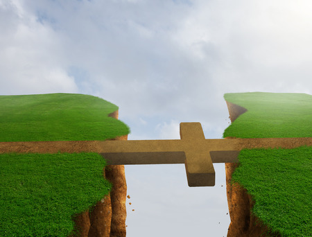 A cross bridges the gap over the cliff to the other side.