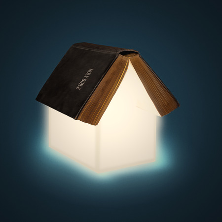 An open Bible with glowing pages creating the shape of a house.