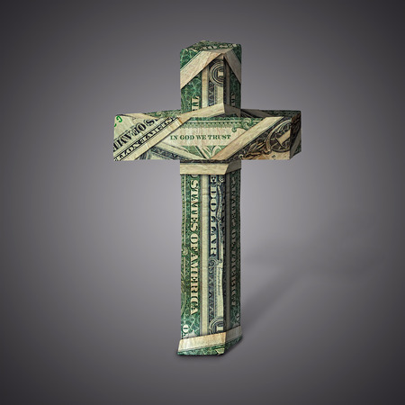 Dollar bills into the shape of a Christian cross. Imagens