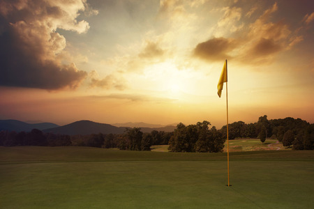 sundown: Beautiful sunrise on the golf course with colorful clouds. Stock Photo