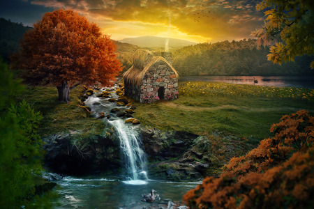 Beautiful nature scene with cottage in the mountains near a stream.
