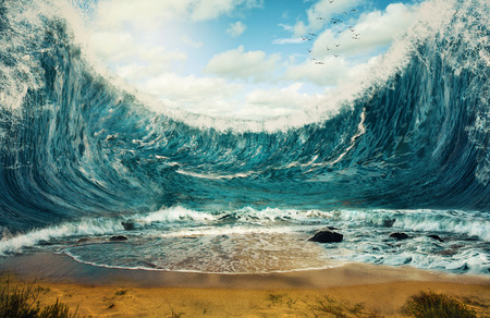 with ocean: Surreal image of huge waves surrounding dry sand.