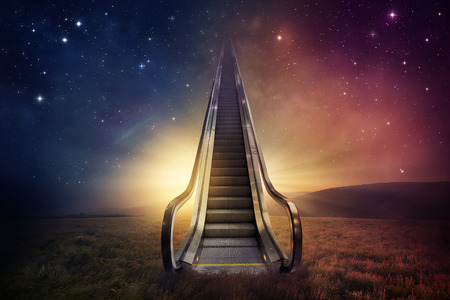 An escalator goes up to the night sky. Imagens