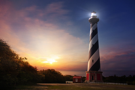 Cape Hatteras lighthouse at sunrise on the North Carolina shore Stock fotó