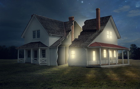 split: A house broken into two with light and darkness. Stock Photo