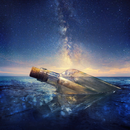 messages: Message in a bottle under a beautiful night sky. Stock Photo