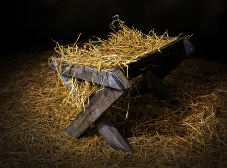 hay: An old manger filled with straw. Stock Photo
