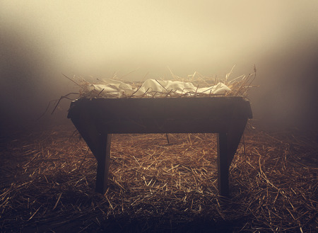 jesus: An empty manger at night under the fog. Stock Photo