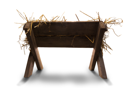 Manger with straw on whie background