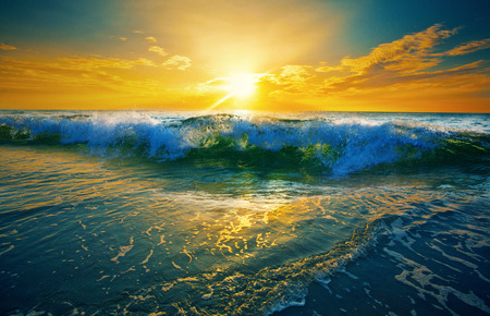 Close up of ocean waves at sunrise.