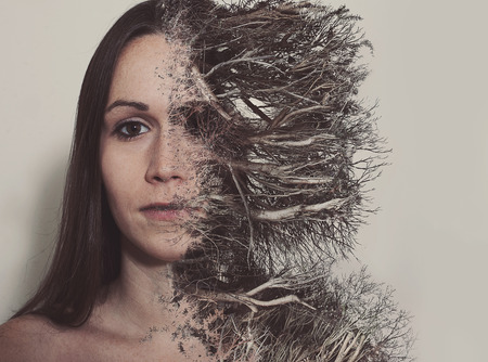A woman's face is consumed by dead branches and roots