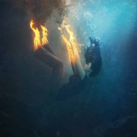 A woman falls into the waters while on fire.