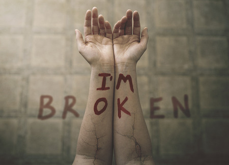 Two arms with painted words.