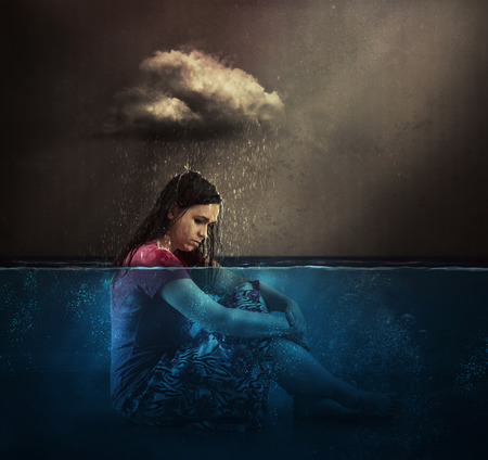 A woman rained on by a single cloud