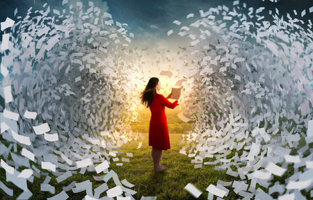 A woman holding a book is surrounded by giant waves of pages.