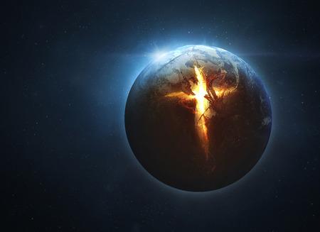 La tierra está dividida abierta por una cruz gigante Foto de archivo