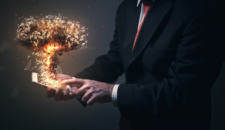 A man holds a cell phone and activates a nuclear bomb Imagens - 109768011