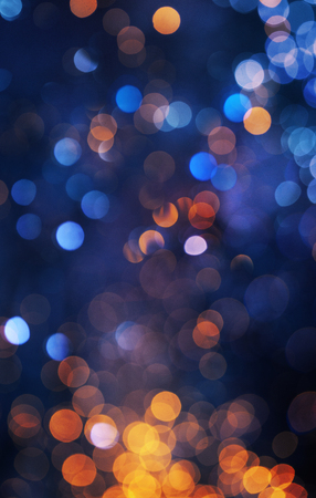 A colorful bokeh background with orange and blue