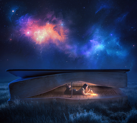 A woman reads a large Bible at night under the stars