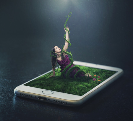 A woman trapped in vines from a cell phone Imagens