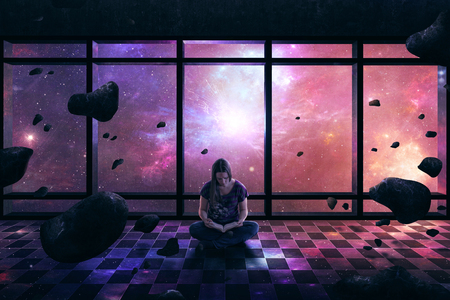 A woman lost in her book as a space scene surround her