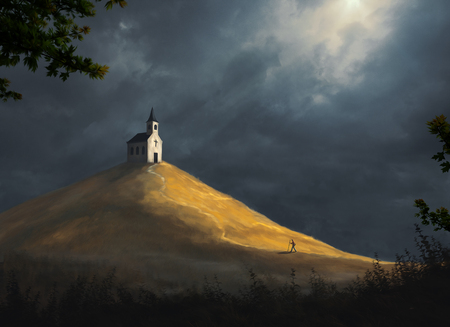 A small church rests on top of a large hill Stock Photo