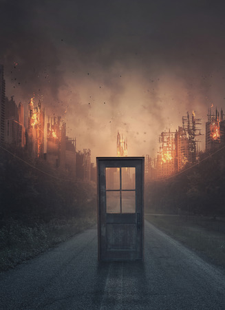 A single door in the middle of a road leading to a city under destruction Stock Photo