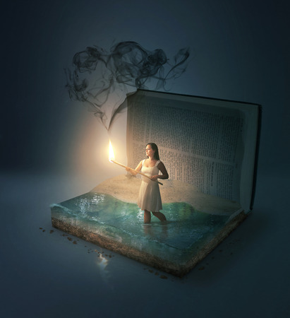 A woman in a Bible with heart shaped smoke. Stock Photo