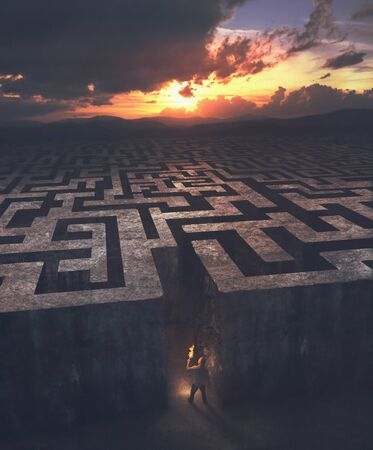 A man enters into a huge maze in the dark