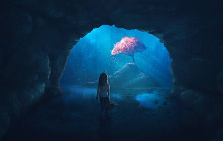 Little girl in cave looks at a beautiful cherry tree Фото со стока