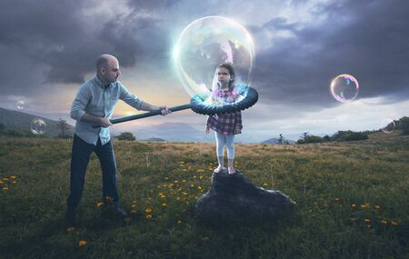 A father puts his reluctant child inside a bubble.