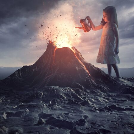 A little girl stands above a volano and pours water to put out the flames