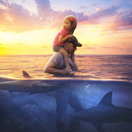 Father and daughter traveling through shark invested waters