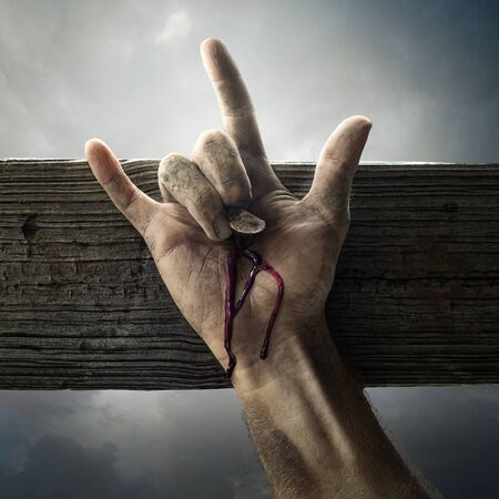 The hand of Jesus on the cross showing the sign for