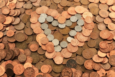 Heart shaped from a pile of UK coins photo