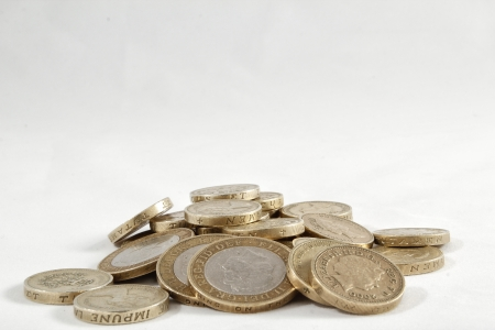 pound coins: A pile of one and two pound coins