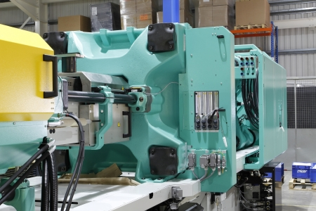 thermoplastic: Injection moulding machine used for the forming of plastic parts using plastic resin and polymers.