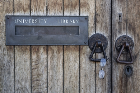 University library letterbox with a pair of reading glasses hung on the handle. Stock Photo - 20355528