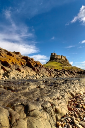 Lindisfarne Castle is a 16th-century castle located on Holy Island, near Berwick-upon-Tweed, Northumberland, England, much altered by Sir Edwin Lutyens in 1901  The island is accessible from the mainland at low tide by means of a causeway The castle is lo Stock fotó