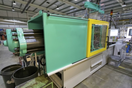 polymer: Injection moulding machine used for the forming of plastic parts using plastic resin and polymers  Stock Photo