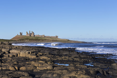 Dunstanburgh Castle lies on a spectacular headland on the coast of Northumberland in northern England, between the villages of Craster and Embleton  The castle is the largest in Northumberland and was started in 1313 by the Earl of Lancaster The castle oc